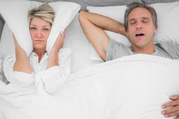 Man snoring loudly keeping partner awake